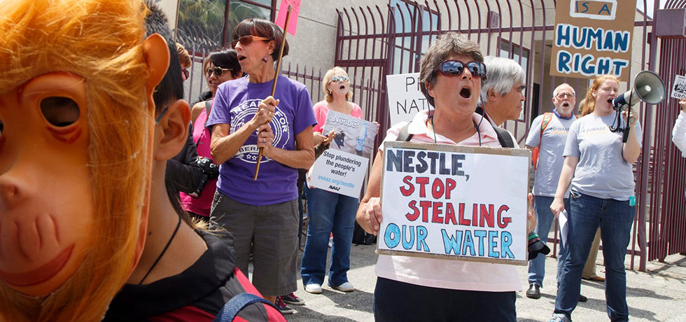 Demonstrators protest against Nestle water bottling operations in California. According to news reports, Nestle, which operates five bottling plants in California, uses 244m gallons of water annually. Reports also said that its state water permit expired 27 years ago. Photograph: Eugene Garcia/EPA via The Guardian
